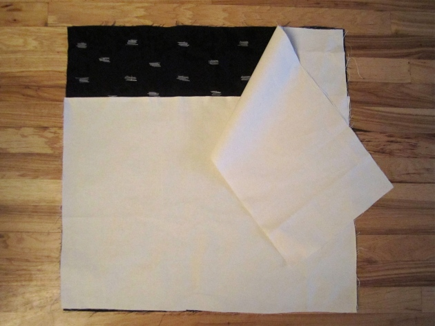 Sewing the cover - patterned fabric right-side up, with overlapping canvas pieces making the envelope in the back.